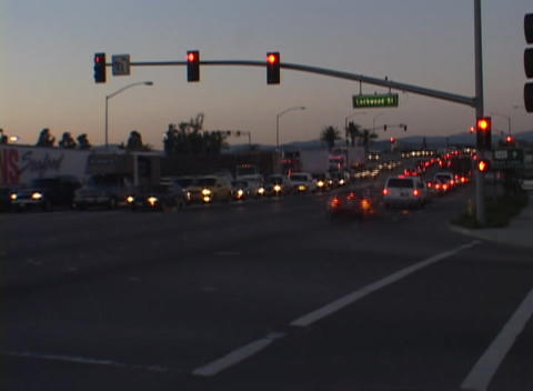 A time-lapse look at a busy intersection from daylight to dark Footage