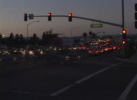 A time-lapse look at a busy intersection from daylight to... Stock Video Footage