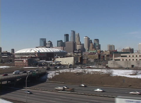 A winter look at a downtown skyline with traffic and... Stock Video Footage