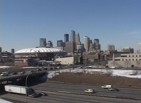 A winter look at a downtown skyline with traffic and freeways Footage