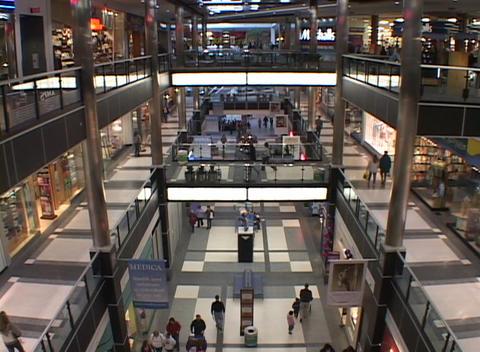 Bird's eye view of people walking through a large... Stock Video Footage