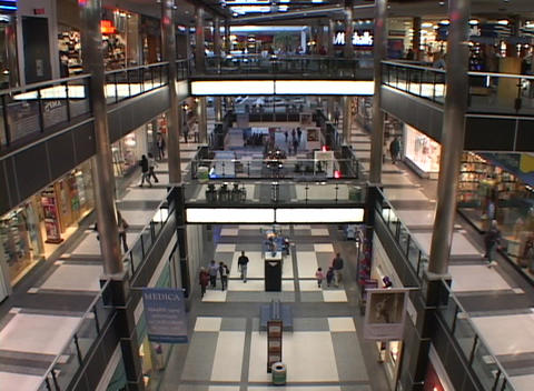 Bird's eye view of people walking through a large shopping mall Footage