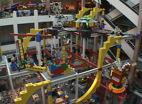 A multi-level shopping mall features a large Lego toy display Footage