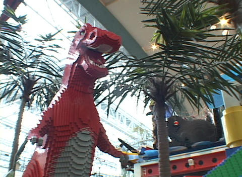 A giant dinosaur is part of a Lego display and play area... Stock Video Footage