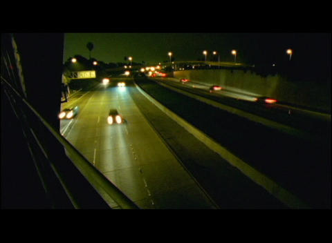 Traffic travels down a freeway Footage