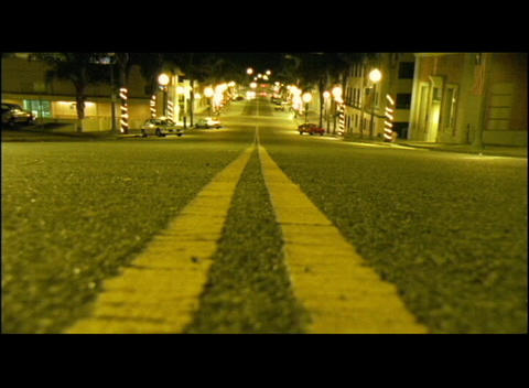 Double yellow lines mark a city street Stock Video Footage