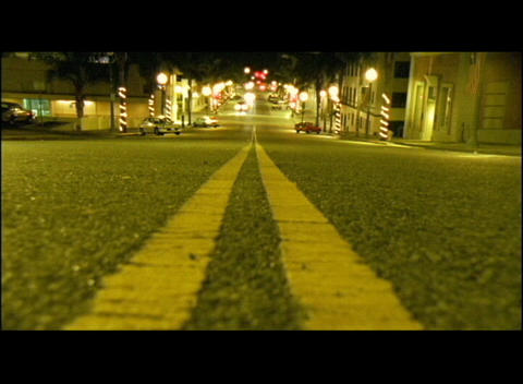 Double yellow lines mark a city street Footage