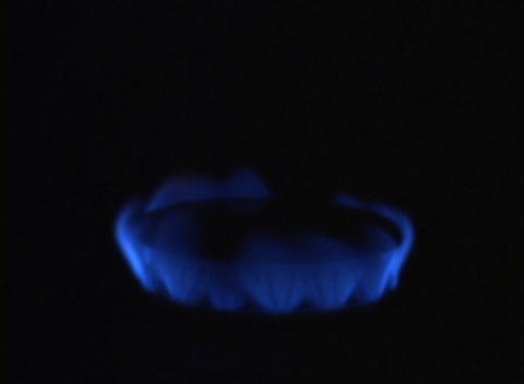 The flame on a gas burner grows larger Stock Video Footage