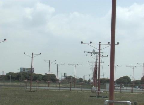 A jet flies low over landing lights Stock Video Footage