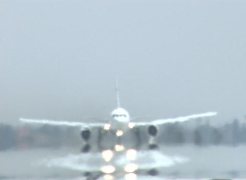 A plane takes off and leaves its reflection on the wet... Stock Video Footage
