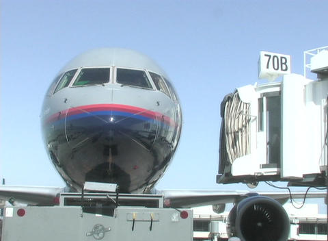 A passenger loading dock pulls away from a jet Stock Video Footage