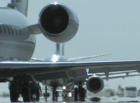 airplanes taxi on a runway Stock Video Footage