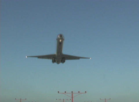 A plane flies over the marker lights on a landing strip Stock Video Footage