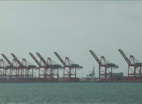 A large boat transport items passes through a body of water Stock Video Footage