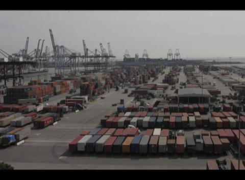A time-lapse of traffic in a port full of cargo containers Stock Video Footage
