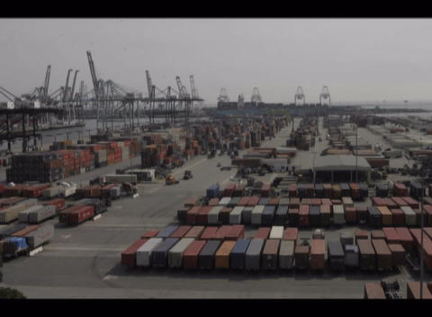 A time-lapse of traffic in a port full of cargo containers Footage