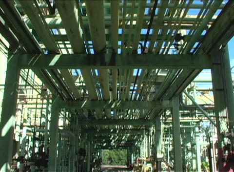 The camera pans the underneath of a large construction... Stock Video Footage