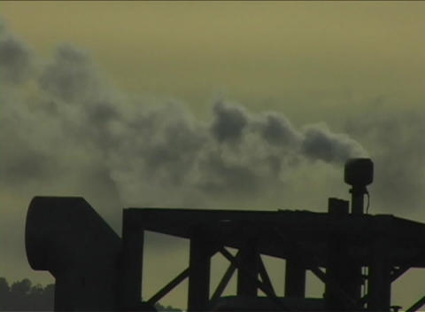 Steam emits from the top of a piece of heavy equipment at golden-hour Footage
