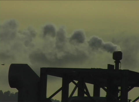 Steam emits from the top of a piece of heavy equipment at... Stock Video Footage