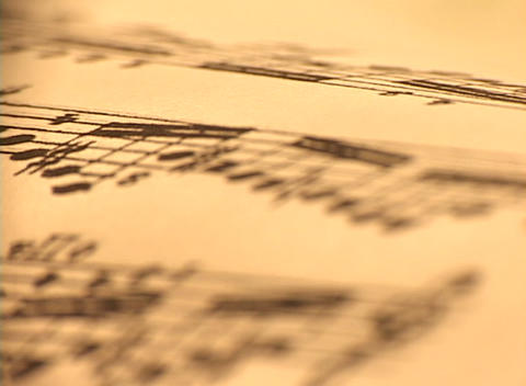 Sheet music goes in and out of focus Stock Video Footage