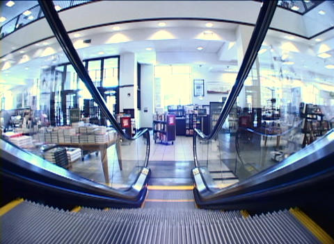 A ride down an escalator is seen from the perspective of... Stock Video Footage