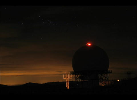 An accelerated view of a dark sky flowing over a lighted... Stock Video Footage