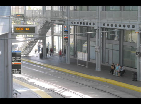 An accelerated view of red trolleys stopping for... Stock Video Footage