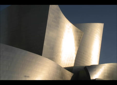 Tall sculptured buildings against a background of blue... Stock Video Footage