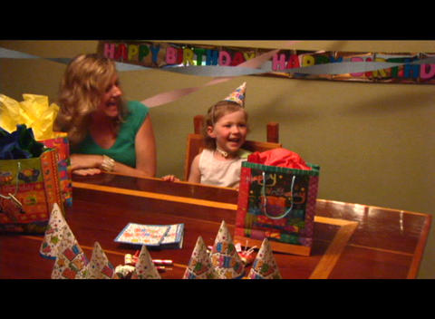 Medium shot of a girl blowing out the candles on her... Stock Video Footage