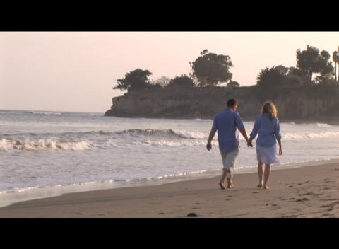 Medium shot of a couple strolling on the beach Footage