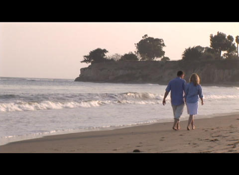 Medium shot of a couple strolling on the beach Stock Video Footage