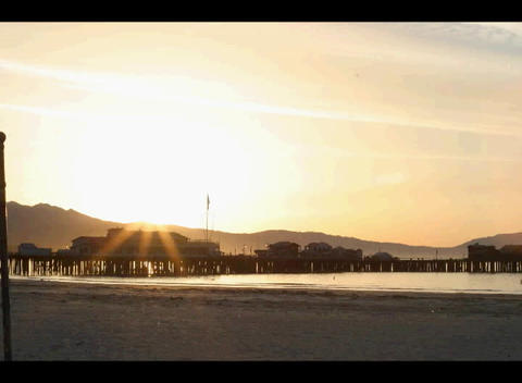 The beach glows with the early morning sun Footage