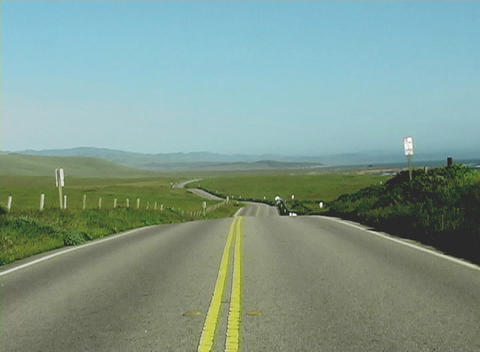 A rural highway stretches into the distant horizon Stock Video Footage