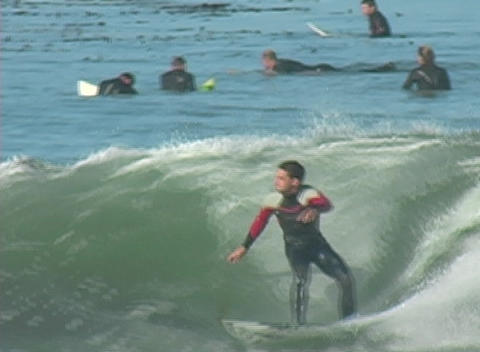 A surfer does well initially and then takes a dive into... Stock Video Footage