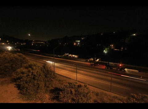 A time-lapse view of a highway at night near a city Stock Video Footage