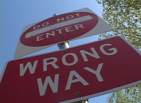 A tilted worm's eye view of a 'Do Not Enter', 'Wrong Way'... Stock Video Footage