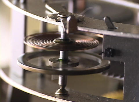 Close-up of a time-piece's moving flywheel and spring Footage