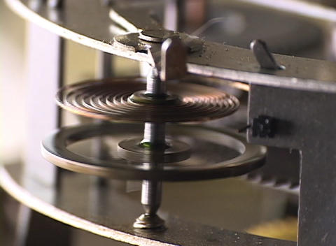 Close-up of a time-piece's moving flywheel and spring Stock Video Footage