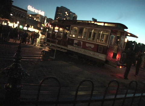 Tilt shot of workers manually turning a cable car Stock Video Footage