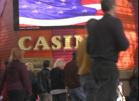 Pedestrians walk past a casino Stock Video Footage