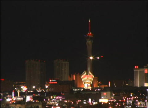 A jet soars past the lit up Las Vegas skyline Stock Video Footage