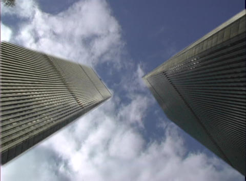 Skyscrapers rise to dizzying heights as clouds pass... Stock Video Footage