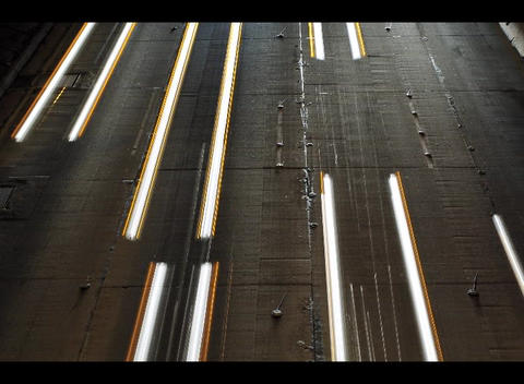 Traffic blurs into streaks of light in this accelerated shot of a freeway at night Footage