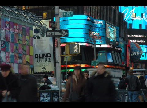 An accelerated shot of people and traffic moving through Times Square in New York City Footage