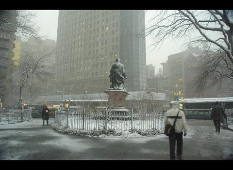 Accelerated shot of people walking through a city park during a light snowstorm Footage
