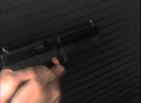 A woman prepares to fire a pistol Stock Video Footage