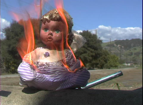 A child's doll catches fire and burns Footage