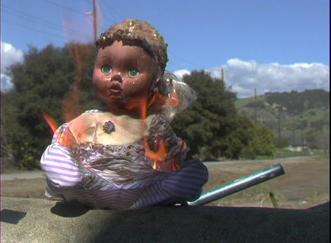 A child's doll catches fire and burns Stock Video Footage