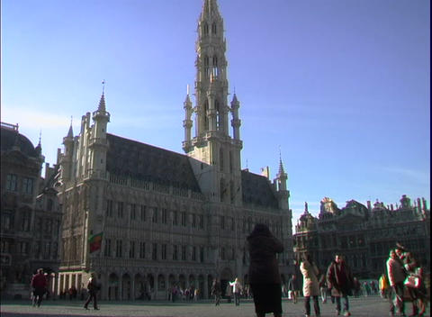Pedestrians walk around an ornate cathedral Stock Video Footage