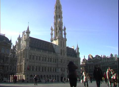 Pedestrians walk around an ornate cathedral Footage